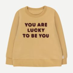 """You are lucky to be you"" Sweatshirt in Sand/Aubergine"